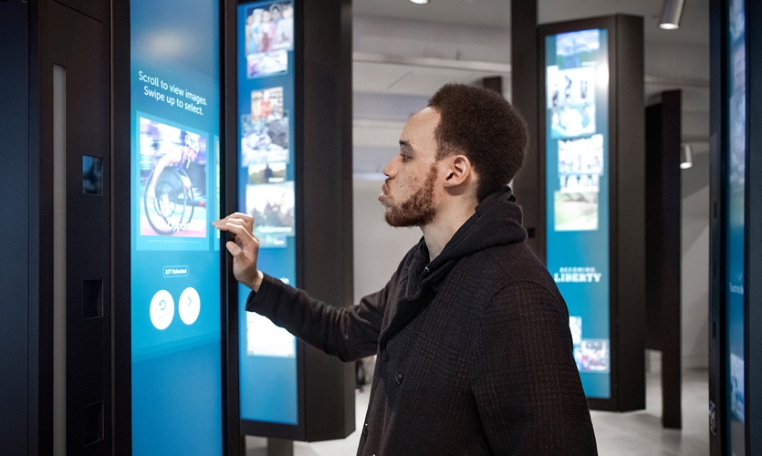 The 20 kiosks in Becoming Liberty prompt visitors to share their own portrait and a set of images that express their perspectives on the meaning of liberty, which then join the ever-growing Becoming Liberty digital mural.  (Keena Photo)