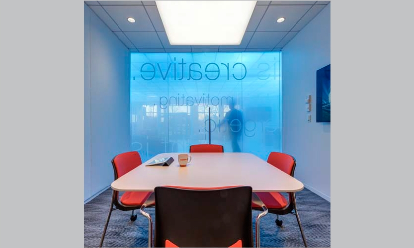 """Even within the conference rooms inside the lobby, the """"light is"""" brand is present. (Photo: Anton Grassl/Esto)"""