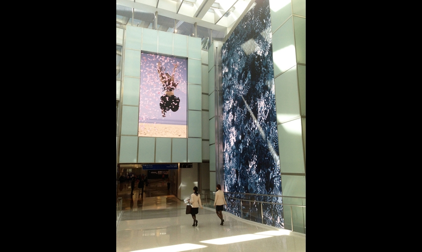 The Bon Voyage Wall, positioned to catch the eyes of outbound passengers as they collect themselves after security, features slow-motion video of Los Angelenos waving goodbye. (Photo: Moment Factory)