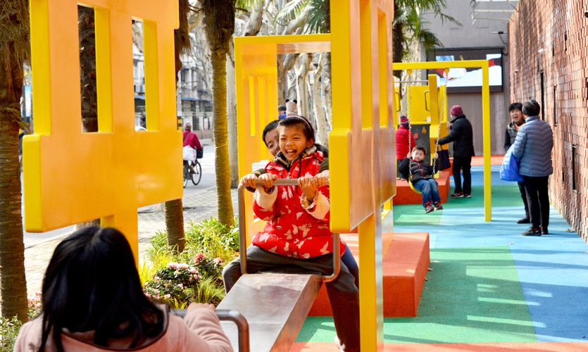 The placemaking solution associating the letters with playful facilities and a bright, colorful pavement, as well as the self managed community garden.