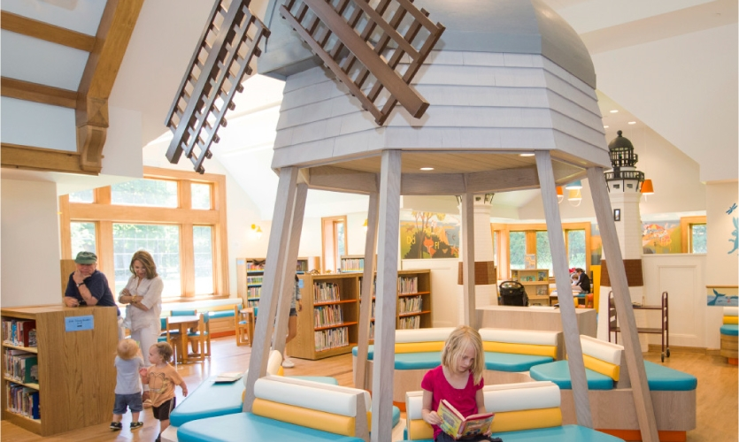 Marlena Oellrick, 8, enjoys a book at the Children's Reading Room at East Hampton Library. [Photo: Randee Daddona]