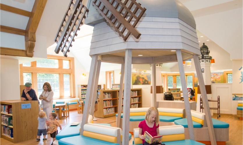 Marlena Oellrick, 8, enjoys a book at the Children's Reading Room at East Hampton Library. [Photo: Randee Daddona]