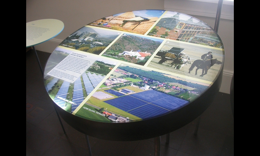 Tabletop lightboxes featured multilayered information about communities that have adopted innovative sustainable strategies. To create depth, images and text were printed directly on both sides of the plexiglass.