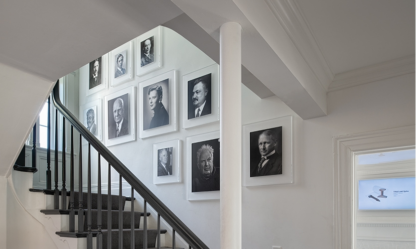 Portraits of notable Stevens alumni are displayed in the stairwell, adding to the narrative while integrating into the homelike space.