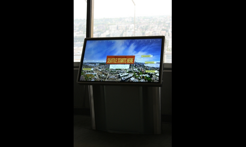 The 520 Teleporter digital kiosks instantly teleport guests from where they are, 520 feet in the air, down to some of the coolest spots in Seattle.