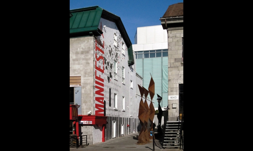 A mural honoring the 50th anniversary of the death of renowned Canadian abstract painter Paul-Emile Borduas was commissioned for the passageway outside Montreal's Grande Bibliotheque du Quebec on Saint-Denis Street.
