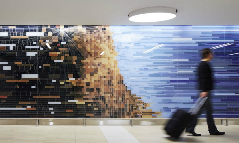 At Chicago O'Hare's newly renovated International Terminal 5, a 300-ft.-long entry wall carries an abstract composition based on the Chicago street grid and map.