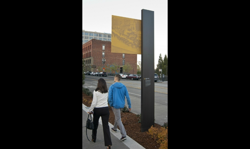 Distinctive pillars and illustrative panels reference Tacoma's industrial and railway legacy.