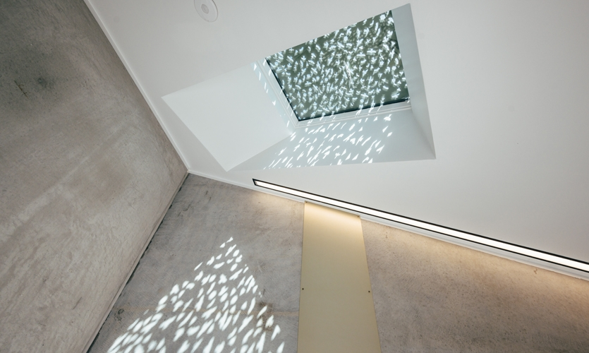 Concealed skylights create a hidden element to the architecture; the sunlight casts the shapes onto the internal walls.