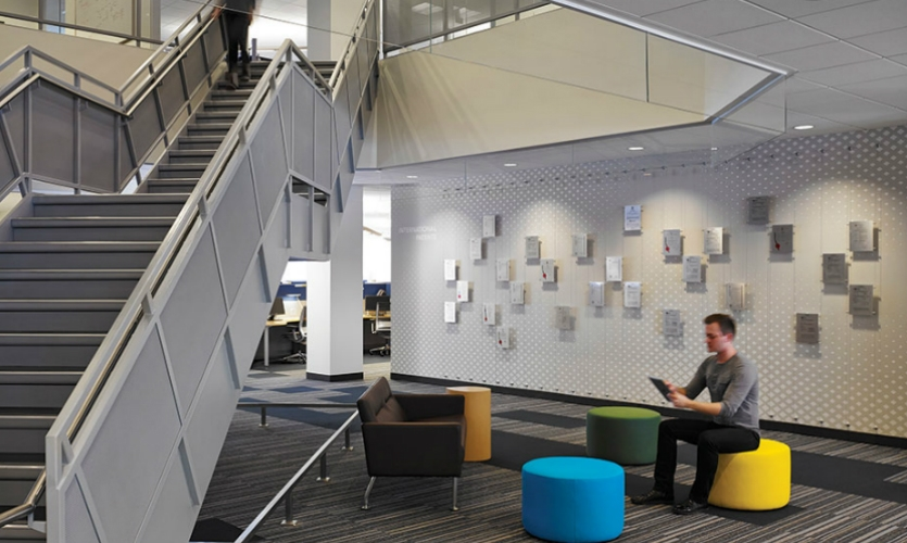 In another public space, Textura's patents and copyrights are displayed on an artful feature wall.