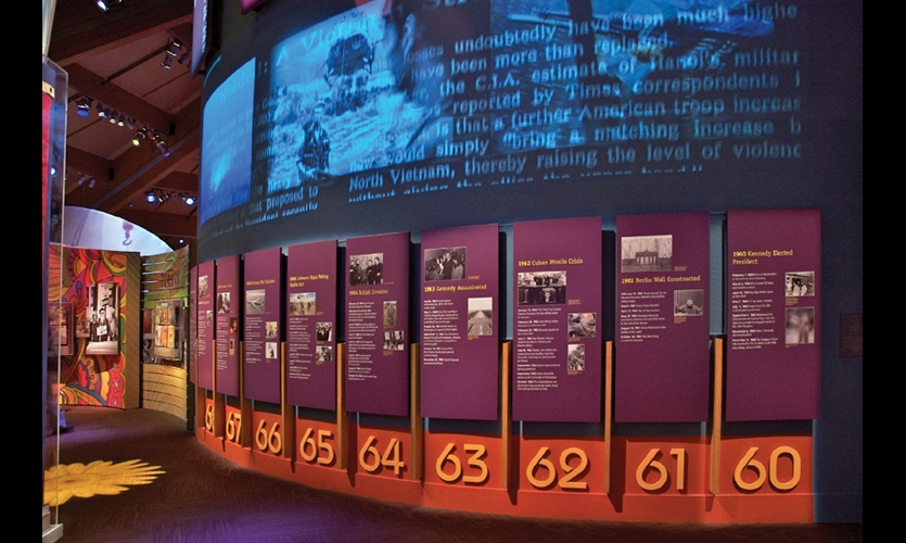 A dimensional timeline at the Museum at Bethel Woods uses static text and video to capture the tumultuous era. (Design: Gallagher & Associates. Fabrication: Hadley Exhibits)