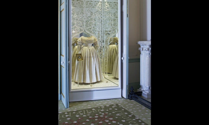Victoria's costumes are presented in jewel boxes with paper artist Andy Singelton's expressive work.