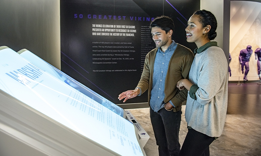 The large, animated, rear-projection illuminated acrylic book has a decidedly lively appeal to it; visitors can walk up and scroll through the pages of Vikings history, the stories and bios of their 50 greatest players and more, using simple gestures.