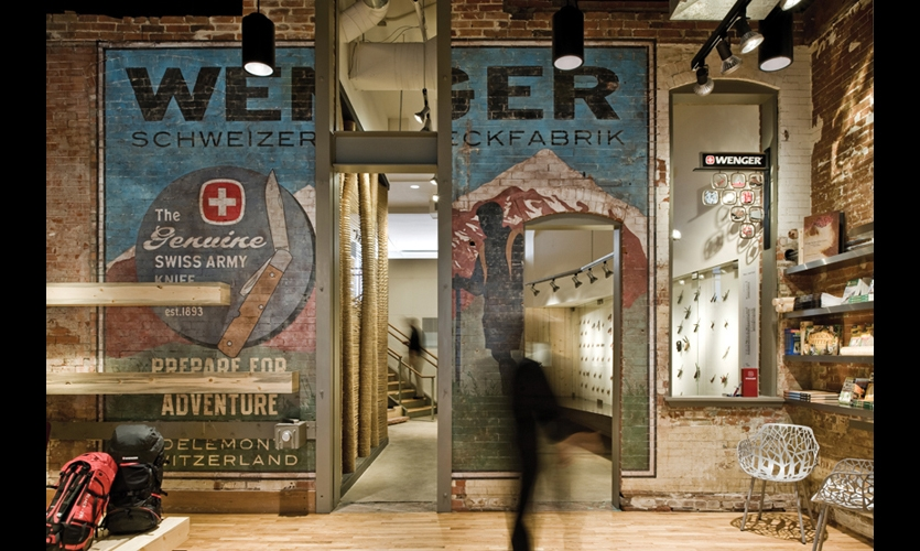 At the Wenger flagship store in Boulder, a hand-painted ghost mural on the exposed brick wall visually separates the product lines and speaks to Wenger's brand heritage.