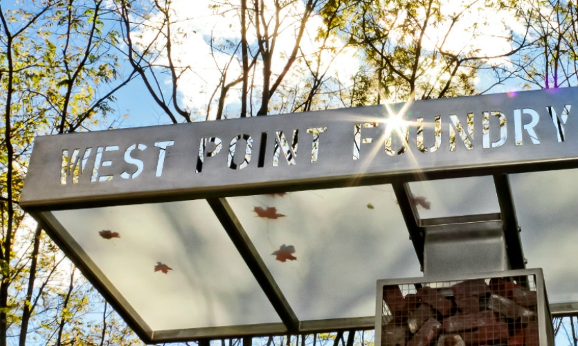 The canopy of the welcome kiosk features laser-cut lettering identifying the preserve.