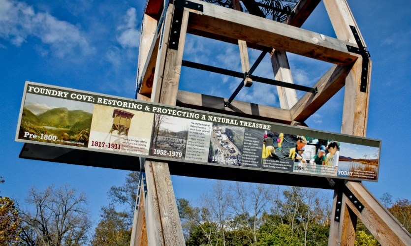 The tower incorporates an 11-ft.-long timeline of the site, from the pre-1800s to the 1800s use of the gun platform up to the marsh's 20th century Superfund cleanup.