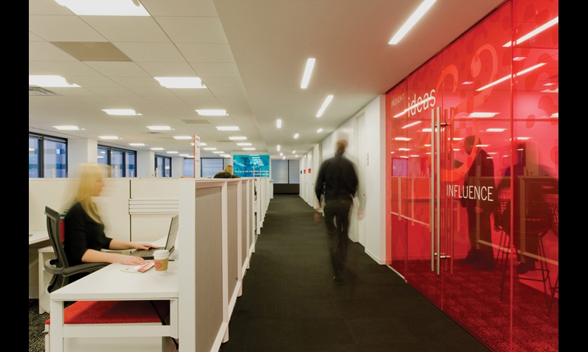 When four internationally recognized creative agencies co-located in WPP's Denver offices, Gensler created a flexible wayfinding strategy that integrates color coding and changeable brand imagery to define individual agency spaces. (Fabarication: Arapahoe Sign Arts. Photo: Blake Mourer)