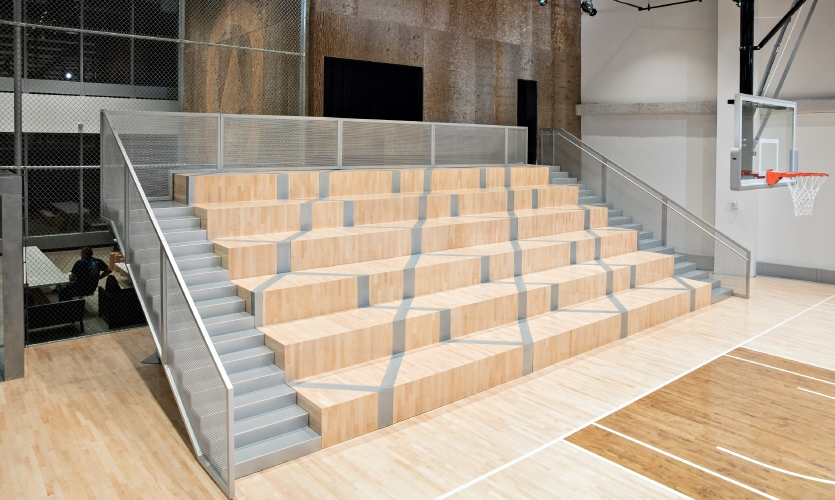 The bleachers are almost 40 feet wide, 18 feet deep and 12 feet high and the structure of the aluminum frame intentionally mimics the shape of a basketball net when viewed from above.