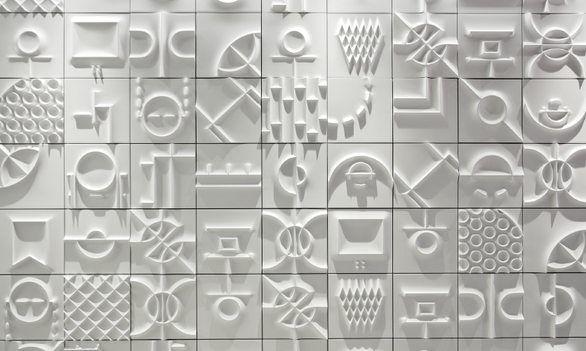 Like the multi-sport wall, they are crafted from white high-density foam tiles and feature sports iconography but radiate a radically different mood.
