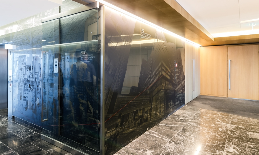UV printed onto dark glass, the overlays and tonal values were carefully chosen to complement the space.