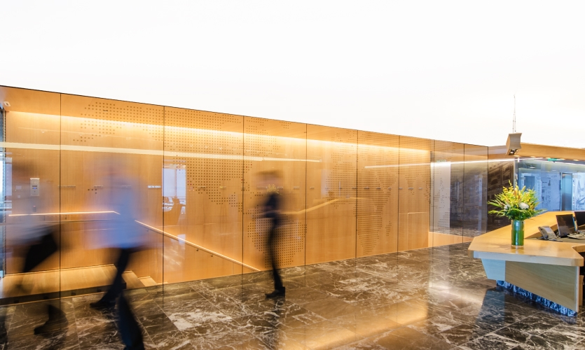 As visitors travel deeper into the office, a long hallway exposes an enormous world map.