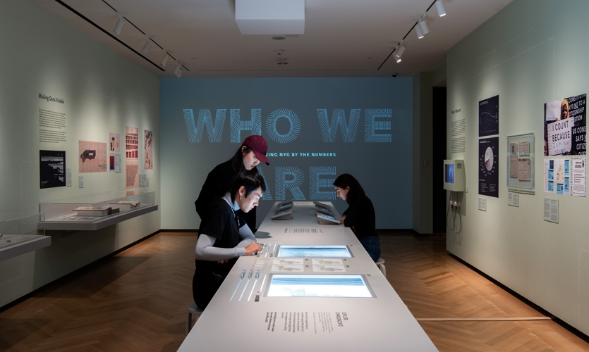 In the Anteroom, visitors encounter a supergraphic title projection with original visualizations (see video), historical artifacts, iPad census stations, and a physical sliding interactive.