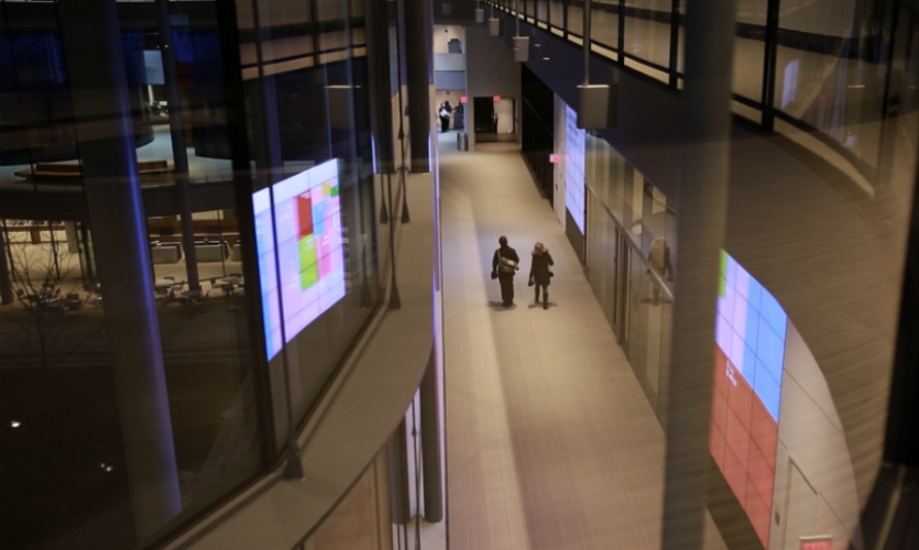 The three-story media platform also displays dynamic graphic visualizations of trending social and economic data.
