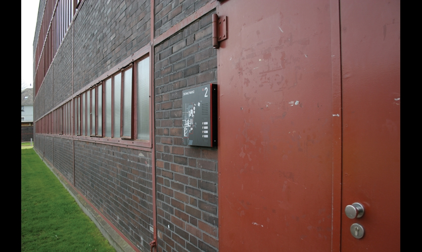 Doorbell panels include small maps that help visitors navigate the more than 100 buildings on the site.