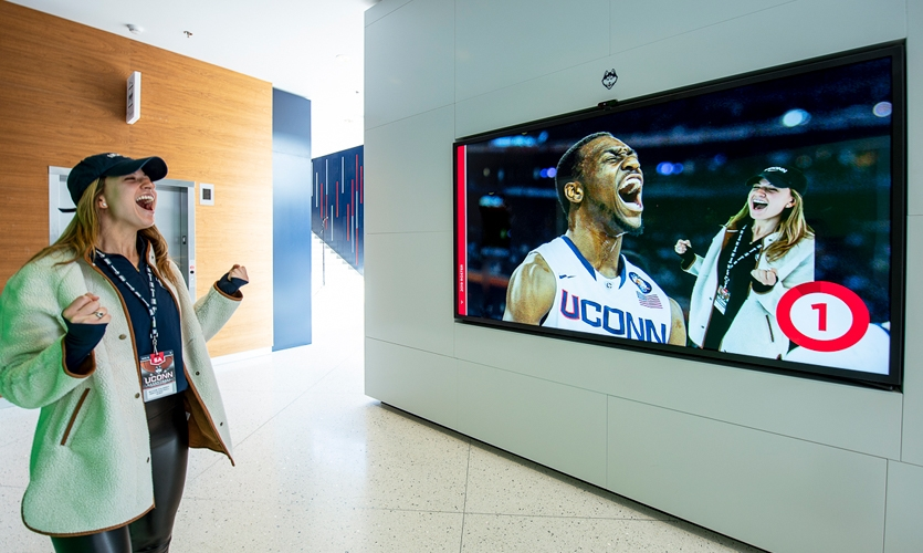 The green screen experiences function simply and effectively with a painted green wall across from a screen outfitted with camera, scene selection and send-to-email functionality, allowing visitors to pose with current players.