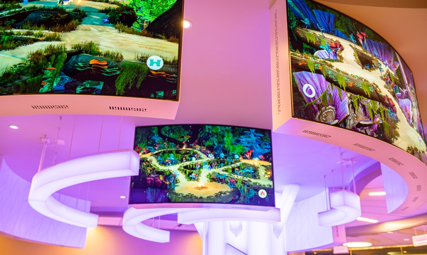 Together with the client team and architects and working within a preset floorplan, they reached the concept of a large, interactive tree in the center of the facility beset with curved OLED screens for easy viewing.