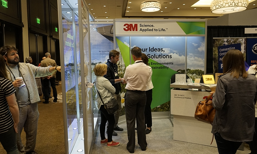 Participants gather at the 3M booth