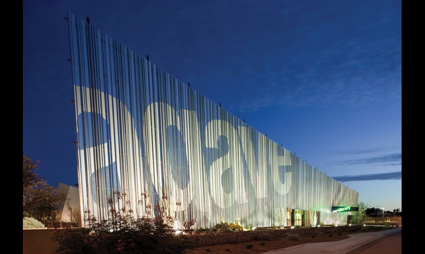 "The 207-ft.-long ""cowboy front"" on the Agave Public Library is constructed of hat channels that taper from 40 ft. down to 26 ft. to meet zoning ordinance height limitations. The 30-ft.-tall ""Agave"" graphic consists of straight strips of white, reflective, adhesive-backed 3M vinyl."