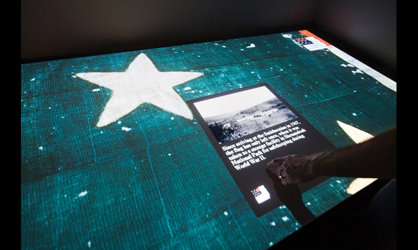 Across from the viewing chamber, an interactive exhibit by Potion allows visitors to explore the flag up close. Multiple users can simultaneously touch the virtual flag, which is projected to actual size, to reveal hidden features and historical facts. (Photos: Chuck Choi)