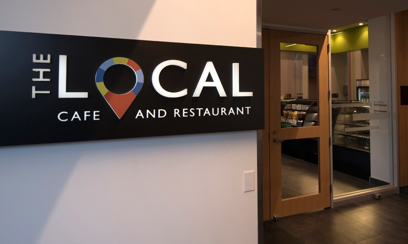 """The café located inside the new building, which the Centennial group dubbed """"The Local,"""" is a full-service, globally-inspired training restaurant concept staffed by students"""