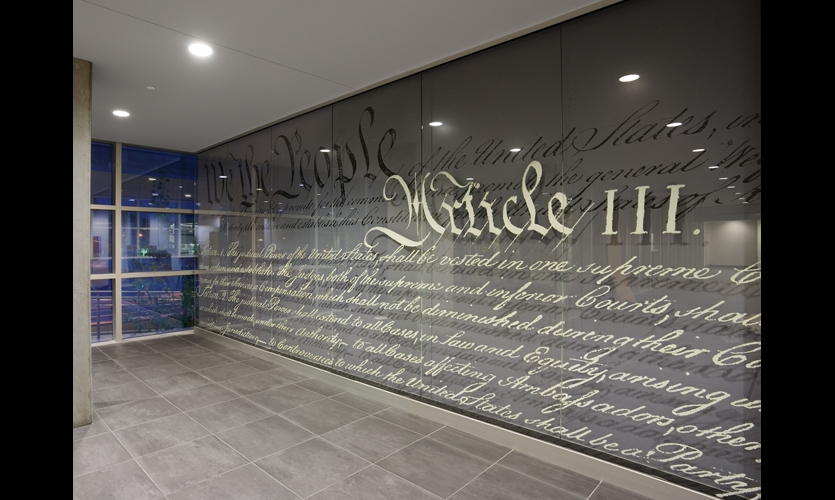 At the Wayne Morse Lyman Courthouse in Eugene, Ore., a welcome mural layers excerpts from the U.S. Constitution on six 47- by 116-in. glass panels.
