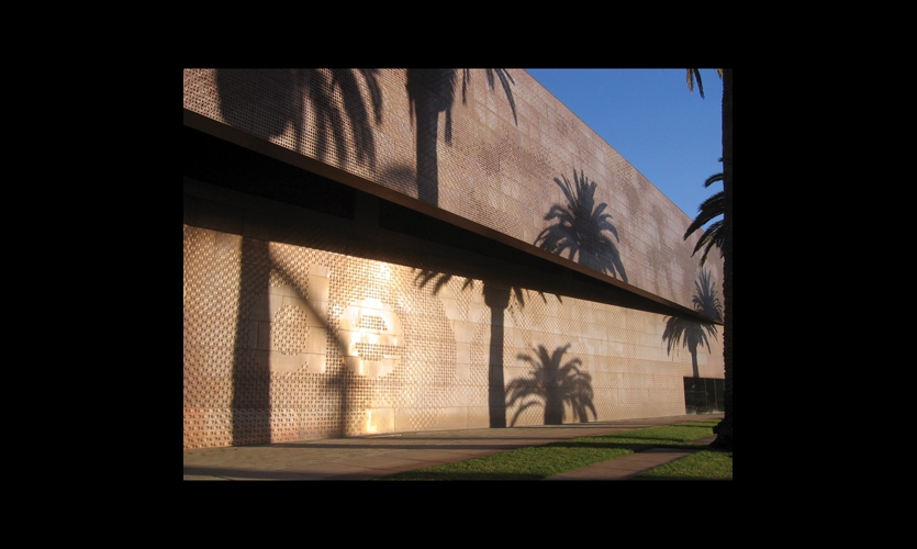 The de Young Museum's identity is embedded into its unique copper skin, designed to recall dappled sunlight filtering through a canopy of leafy trees.