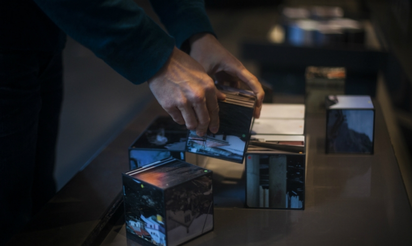 Toward the end of the exhibit, a puzzle interactive allows visitors to move cubes and play with the concept of before and after.