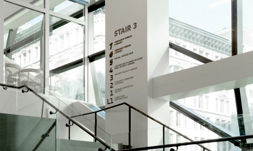 Wayfinding was integrated into the building's communicating staircases, which mesh classroom, living, and social spaces.