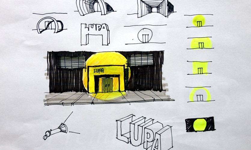 """Lupa"" means ""magnifying glass"" in Portuguese. While reflecting about the façade for this manufacturer, I experimented with ways of ""zooming in"" or ""highlighting"" its entrance."