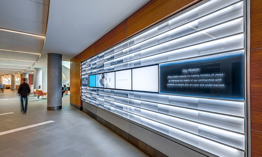 In healthcare facilities, the physical environment can communicate a mission of compassion and caring. Kolar Design created environmental graphics for Mercy Health's West Hospital.