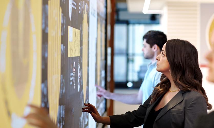Multiple Hamburger University visitors can explore interactive content