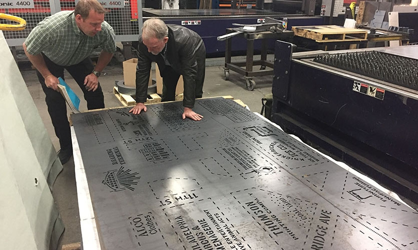 The design team had to break the artwork down into smaller sections for the laser cutter's computer to process it correctly, as well as modify the artwork several times to reduce sharp corners and enhance legibility.