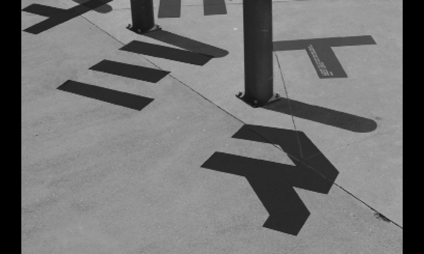 The cropped typeface became whole when shadows were cast.