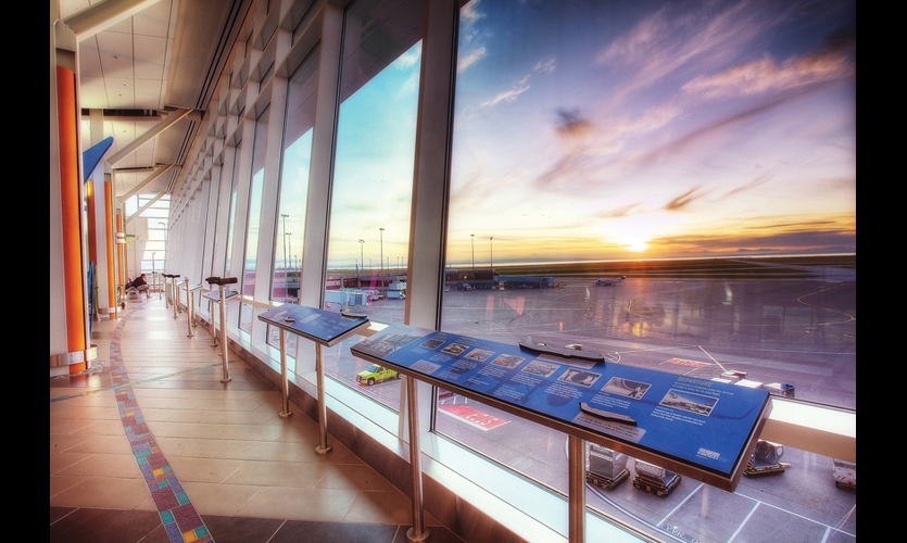 Along a row of floor-to-ceiling windows overlooking the airfield and the Strait of Georgia, a series of static information panels answer visitors' basic questions about airport operations and connect them with the natural environment. (Photo: Ben West)
