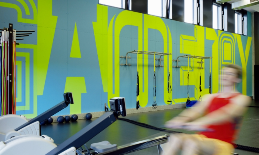 Buro Uebele used super-scaled typography to pump up the energy in the gym at Adidas headquarters in Herzogenaurach, Germany.