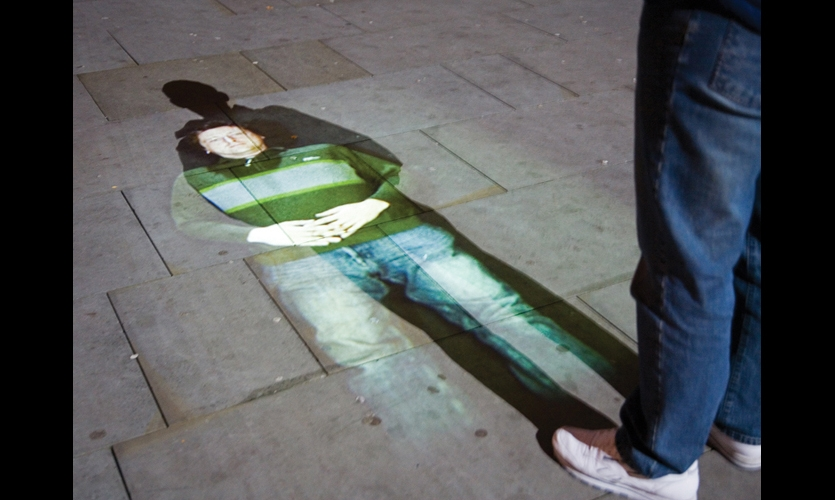 In Rafael Lozano-Hemmer's Under Scan public art project in England, the shadows of passersby revealed video portraits animated on the ground. When passersby stood still, the portraits interacted with them. (Photo: Antimodular)