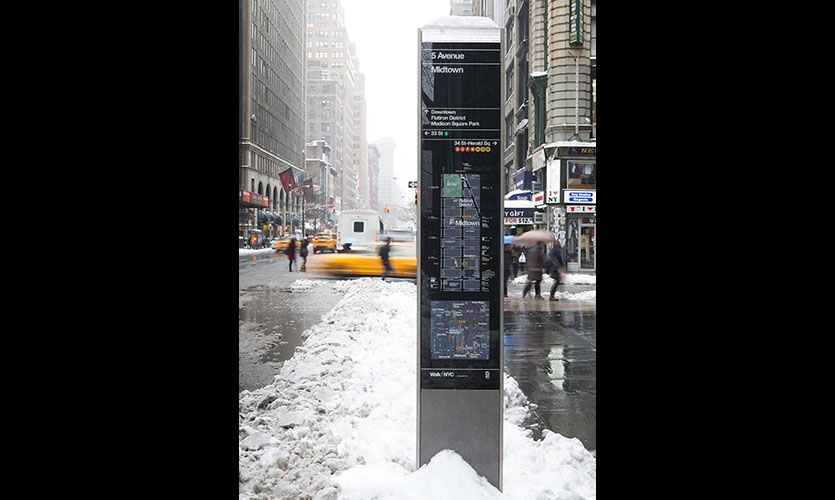The kiosks present two maps, one of local streets and the other of the area's location in relation to a larger section of the city.