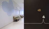 Zoom in the wall graphics. In the back, an examination waiting room.