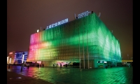 The animated exterior of the Dream Cube, made of a structure of recycled CD cases and thousands of LEDs, pulses with the movements and sounds of the visitors within it.