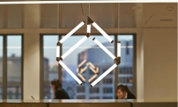 At Charter Hall's new headquarters in Sydney, a sculptural light element inspired by Charter Hall's logo was a collaboration between Frost*collective and Arup Lighting.